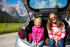 Girls at the car trunk Royalty Free Stock Photography