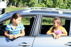 Girls in car windows Royalty Free Stock Photography