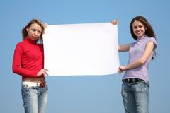 Girls with card for text royalty free stock photos