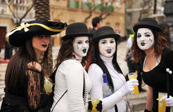 Girls in Carnaval of Cadiz, Andalusia, Spain. Girls with painted face dressed as a mime during the Carnival of Cadiz in Spain Stock Photo