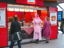 Girls in carnival costumes near the cafe fast food in town of He Royalty Free Stock Images