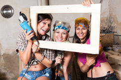 Girls in the carpentry shop carpenters Royalty Free Stock Image