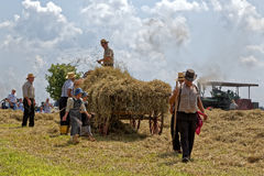 Girls Carry Water for the Hay Crew Royalty Free Stock Photography