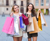 Girls carrying bags with purchases Stock Photos