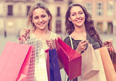 Girls carrying bags with purchases Stock Images