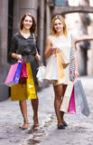 Girls carrying bags with purchases Royalty Free Stock Images