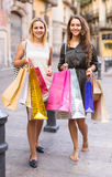 Girls carrying bags with purchases Stock Photo