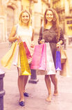 Girls carrying bags with purchases Stock Photography