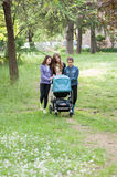 Girls carrying a pram Royalty Free Stock Images