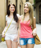 Girls in casual walking through ancient European city Stock Photography