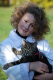 Girls cat. The girl holds on hands of a cat Stock Images