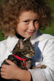 Girls cat. The girl holds on hands of a cat Stock Photography