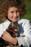 Girls cat. The girl holds on hands of a cat Stock Photos