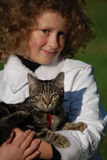 Girls cat. The girl holds on hands of a cat Royalty Free Stock Photo