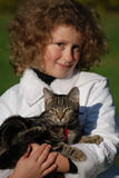 Girls cat. The girl holds on hands of a cat Royalty Free Stock Photography