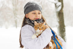 Girls and a cat Stock Photography