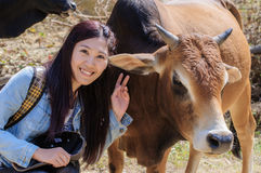 Girls and cattle stock photography