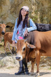 Girls and cattle stock photo