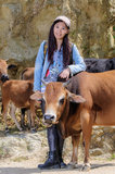 Girls and cattle royalty free stock photography