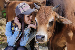 Girls and cattle royalty free stock photos