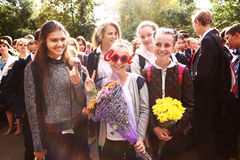 Girls  celebrate their first school day September Moscow. Royalty Free Stock Photography