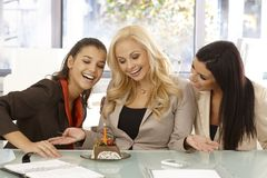 Girls celebrating birthday at workplace Stock Photos