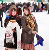 Girls celebrating Shrovetide at Russia royalty free stock image