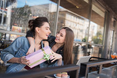 Girls celebrating something on the terrace Royalty Free Stock Images