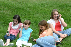 Girls on Cell Phones. Group of girls talking and using cell phones Royalty Free Stock Images