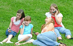 Girls on Cell Phones. Group of Girls Talking Using Cell Phones Royalty Free Stock Photography