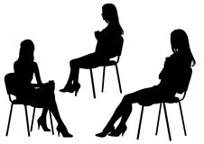 Girls on chair Royalty Free Stock Image