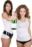 Girls with a champagne bottle Royalty Free Stock Image