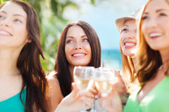 Girls with champagne glasses Stock Images