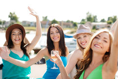 Girls with champagne glasses on boat. Summer holidays and vacation - girls with champagne glasses on boat or yacht Royalty Free Stock Photo