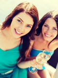 Girls with champagne glasses on boat Stock Photography
