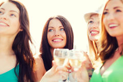 Girls with champagne glasses Stock Photography