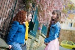 Girls chatting on a Parisian street Royalty Free Stock Image