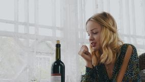 Girls chatting at table with alcohol drinks on terrace of country house. Happy stock footage