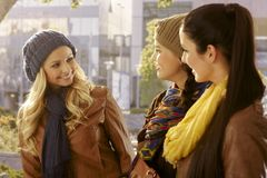 Girls chatting and walking outdoors Royalty Free Stock Images