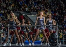 Girls cheerleaders from the team Red Foxes for the match Ukraine vs Romania stock photo