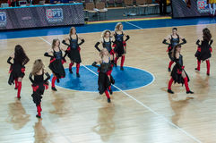 Girls cheerleading appear on basketball parquet Stock Photo