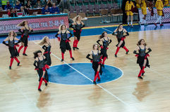 Girls cheerleading appear on basketball parquet Royalty Free Stock Photography