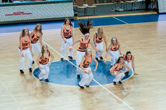 Girls cheerleading appear on basketball parquet Stock Image