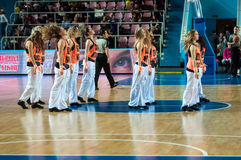 Girls cheerleading appear on basketball parquet Royalty Free Stock Photo