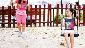 Girls child swinging stock video footage
