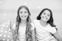 Girls children with long curly hair. Pajamas party concept. Girls just want to have fun. Girlish secrets honest and. Sincere. Friends kids have nice time royalty free stock images