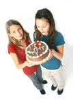 Girls and chocolate cake Royalty Free Stock Photos