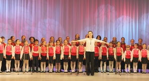 Girls choir. Chorus girls Vognik on the stage of the Kyiv Palace of children and youth. Festival Levels of Excellence Stock Images