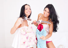 Girls choosing clothes Royalty Free Stock Photography