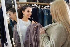 Girls choosing  clothes Royalty Free Stock Photo